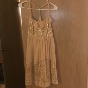 Midi dress. Gold flower sequin on top and bottom.